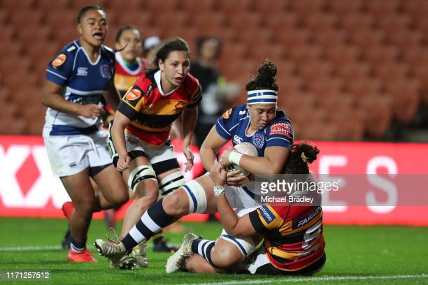 Auckland's Charmaine McMenamin crashes over for a try during the round 1 Farah Palmer Cup match between Waikato and Auckland at FMG Stadium on August...