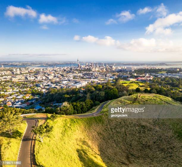 auckland's skyline over mount eden - auckland stock pictures, royalty-free photos & images
