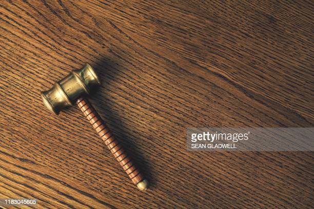 auction hammer on wood - bid stock pictures, royalty-free photos & images