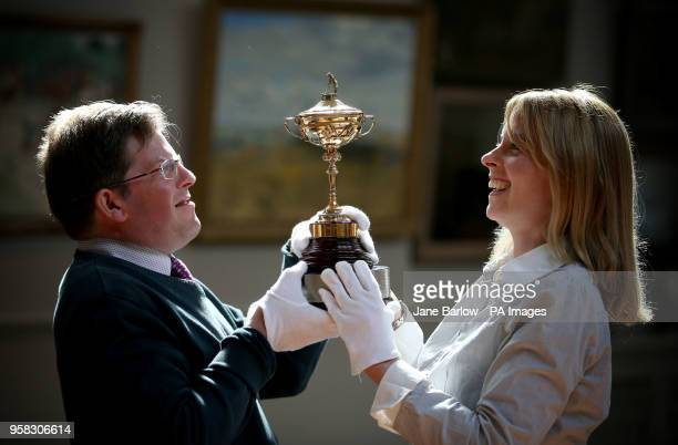 Auction house staff Hamish Wilson and Amanda Dovesi at Bonhams in Edinburgh take a closer look at a replica Ryder Cup The cup presented to Sergio...