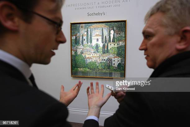 Auction house staff look at a work entitled 'Kirche in Cassone' by Gustav Klimt at Sotheby's auction house on January 12 2010 in London England The...