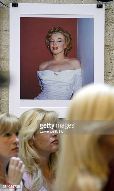 Auction of Marilyn Monroe's personal artifacts such as clothings stockings and make–up items Prospective bidders by a Marilyn Monroe photographs