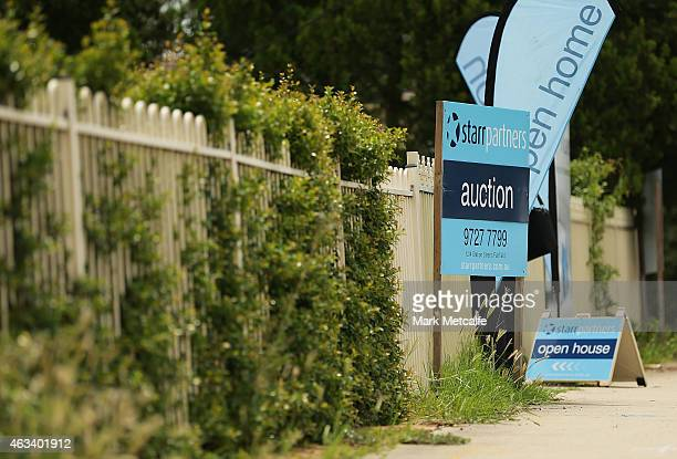 Auction signs stand on display before the home auction for a fourbedroom house at 230 Blacktown Road on February 14 2015 in Blacktown Australia The...