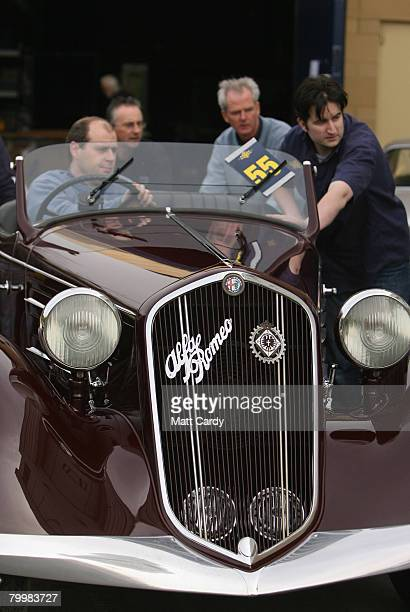 Auction staff move Lot 55 a 1936 Alfa Romeo 6C 2300 Pescara Spyder which was once owned by Benito Mussolini into position at The Centaur Cheltenham...