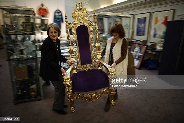 Auction staff move the Bradley Wiggins London 2012 Olympics golden throne into place at Sotheby's on November 6 2012 in London England Graham Budd...