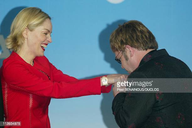 AMFAR auction to benefit the American foundation for aids research In Mougins France On May 23 2002Sharon Stone Elton John