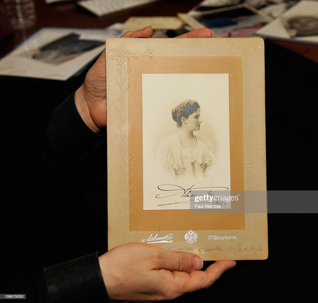 RR Auction Vice President Bobby Livingston holds a rare autographed photograph of Empress Alexandra of Russia of on January 16, 2013 at RR Auction in Amherst, New Hampshire.
