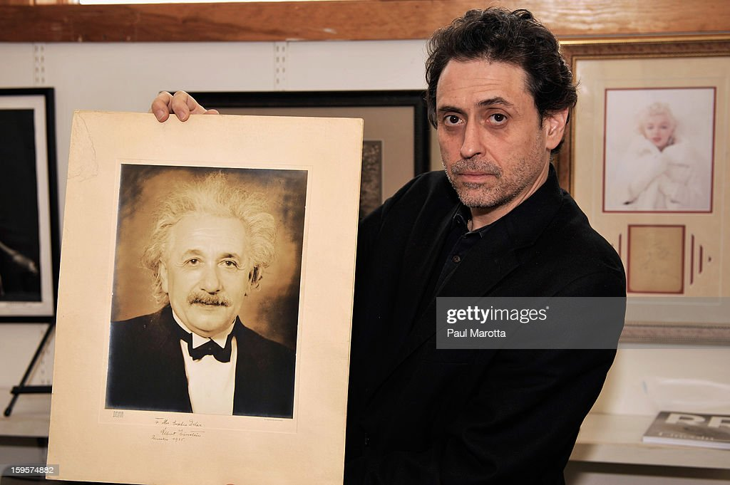 RR Auction Vice President Bobby Livingston holds a rare autographed photograph Albert Einstein of on January 16, 2013 at RR Auction in Amherst, New Hampshire.
