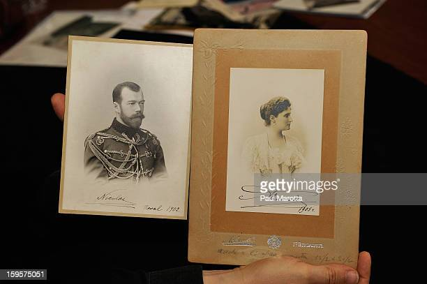 Auction Vice President Bobby Livingston holds rare autographed photographs of Czar Nicolas II and Empress Alexandra of Russia on January 16 2013 at...