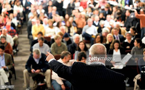 Auctioneer Alasdair Nichol points toward a bidder during an auction of modern and contemporary art including works from the Lehman Brothers Holdings...