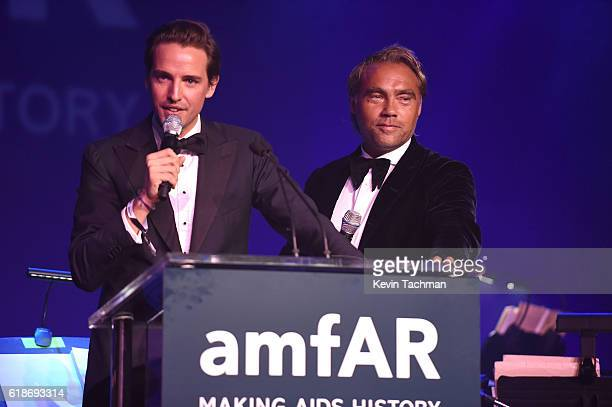 Auctioneer Alexander Gilkes and explorer Johan Ernst Nilson speak onstage at amfAR's Inspiration Gala at Milk Studios on October 27 2016 in Hollywood...