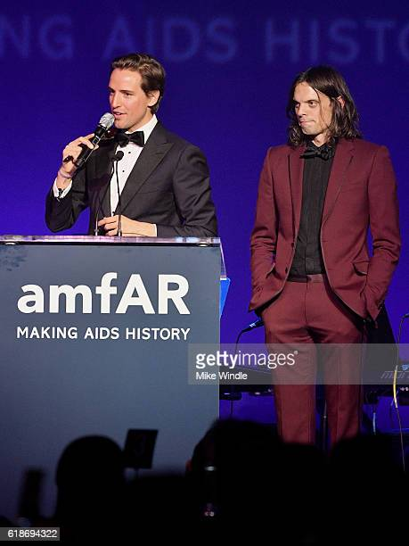 Auctioneer Alexander Gilkes and musician Nikolai Haas speak onstage at amfAR's Inspiration Gala Los Angeles at Milk Studios on October 27 2016 in...