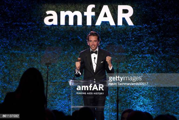 Auctioneer Alexander Gilkes at amfAR Los Angeles 2017 at Ron Burkle's Green Acres Estate on October 13 2017 in Beverly Hills Californi