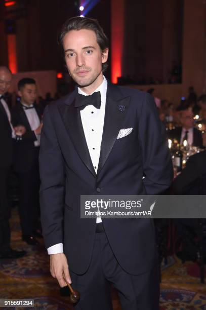 Auctioneer Alexander Gilkes attends the 2018 amfAR Gala New York at Cipriani Wall Street on February 7 2018 in New York City