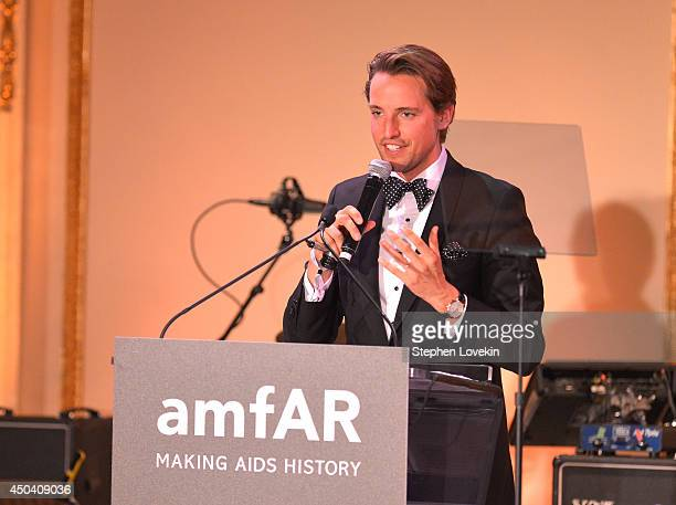 Auctioneer Alexander Gilkes conducts an auction onstage at the amfAR Inspiration Gala New York 2014 at The Plaza Hotel on June 10 2014 in New York...