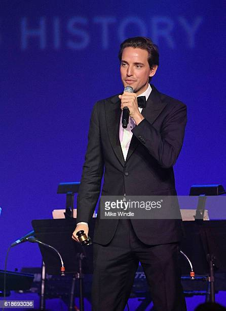 Auctioneer Alexander Gilkes speaks onstage at amfAR's Inspiration Gala Los Angeles at Milk Studios on October 27 2016 in Hollywood California