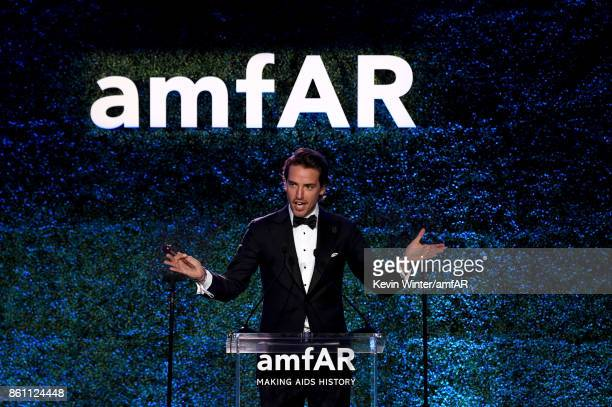 Auctioneer Alexander Gilkes speaks onstage at the amfAR Gala Los Angeles 2017 at Ron Burkle's Green Acres Estate on October 13 2017 in Beverly Hills...