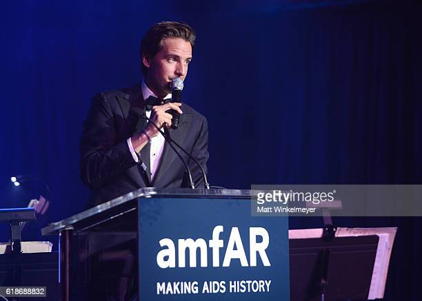 Auctioneer Alexander Gilkes speaks onstage during amfAR's Inspiration Gala Los Angeles at Milk Studios on October 27 2016 in Hollywood California