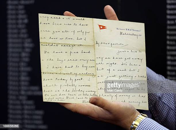 Auctioneer Andrew Aldridge of auctioneers Henry Aldridge son holds a letter from Wallace Hartley the band leader of the Titanic written aboard the...
