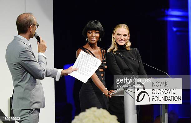 Auctioneer Andrew Boose and models Naomi Campbell and Anne V speak on stage at the Novak Djokovic Foundation New York dinner at Capitale on September...