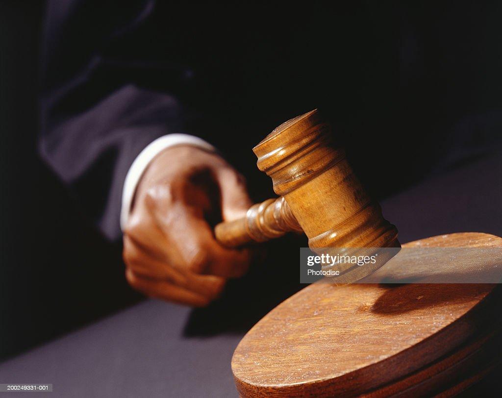 Auctioneer banging gavel, (Close-up) : Stock Photo