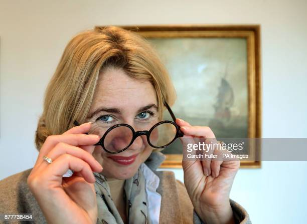 Auctioneer Catherine Southon at Bromley Arts Centre in Bromley, Kent, with a pair of tortoiseshell spectacles made for Winston Churchill by C. W....
