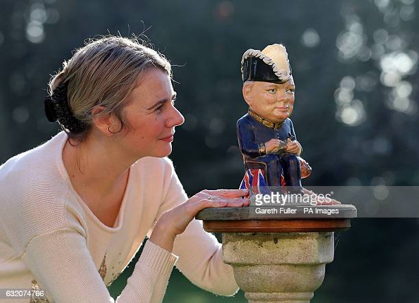 Auctioneer Catherine Southon checks a Clarice Cliff Churchill Toby jug, 1 of 350 ever produced dating from around 1940, which is estimated to sell...