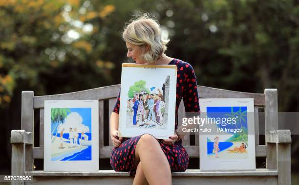 Auctioneer Catherine Southon holds examples from the Smilby cartoon collection, including works that appeared in Playboy, at the Ripley Arts Centre,...