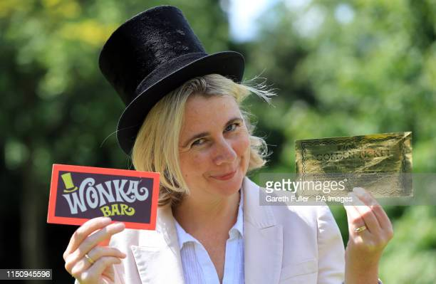 Auctioneer Catherine Southon holds two of the most iconic film props - a Golden Ticket and Wonka Bar from the 1971 film Willy Wonka & the Chocolate...