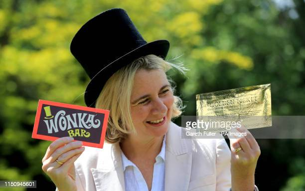 Auctioneer Catherine Southon holds two of the most iconic film props - a Golden Ticket and Wonka Bar from the 1971 film Willy Wonka & the...