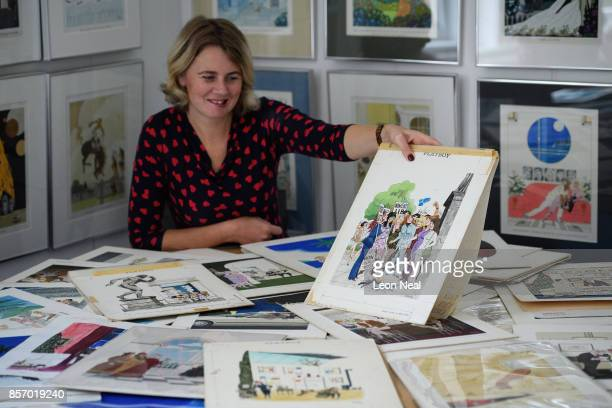"""Auctioneer Catherine Southon poses with some of the hundreds of original works by Playboy cartoonist """"Smilby"""" at a preview of two forthcoming sales..."""