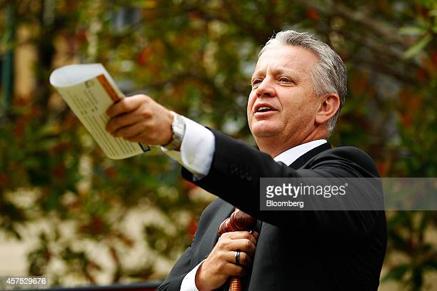 Auctioneer Craig Marshall gestures while conducting bidding during an auction of a property in the suburb of Roseville Sydney Australia on Saturday...