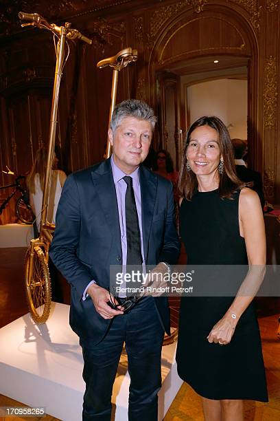 Auctioneer Francois Tajan and CEO of association 'Paris Tout P'Tits' Princess Ariane Poniatowski standing near his bike 'Petit velo pour geant' at...