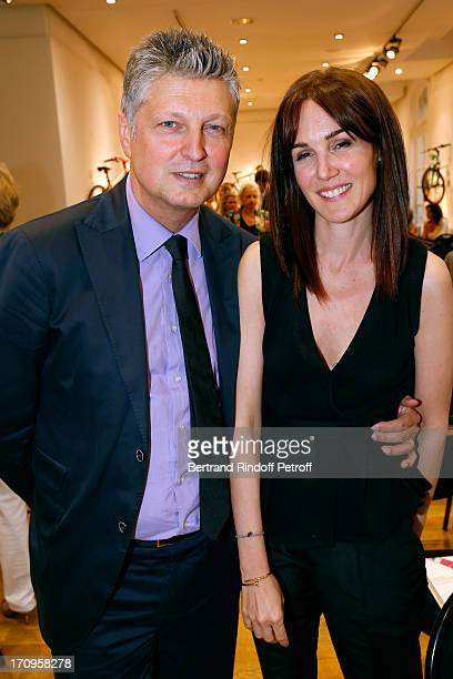 Auctioneer Francois Tajan and his wife Veronique attend 'Arty Bike' Auction to benefit Association des Tout P'tits at Artcurial on June 20 2013 in...