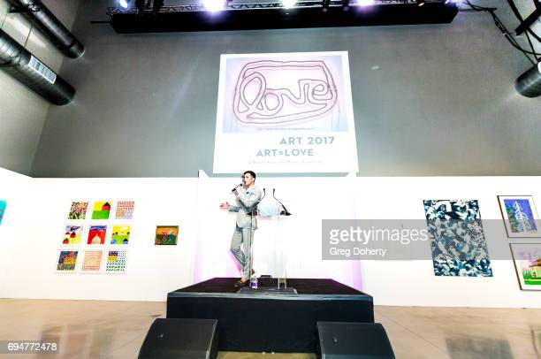 Auctioneer Gabriel Butu conducts the live auction at the Angel Art Fundraiser Hosted by Project Angel Food at NeueHouse Los Angeles on June 10 2017...