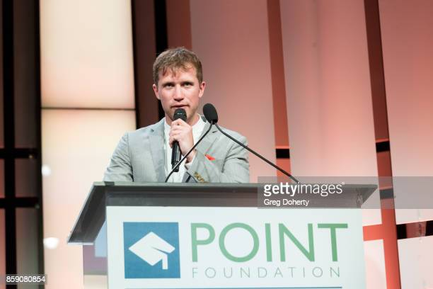 Auctioneer Gabriel Butu on stage at the Point Honors Los Angeles at The Beverly Hilton Hotel on October 7 2017 in Beverly Hills California