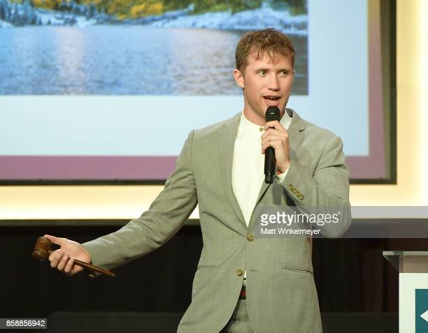 Auctioneer Gabriel Butu speaks onstage at Point Honors Los Angeles 2017 benefiting Point Foundation at The Beverly Hilton Hotel on October 7 2017 in...