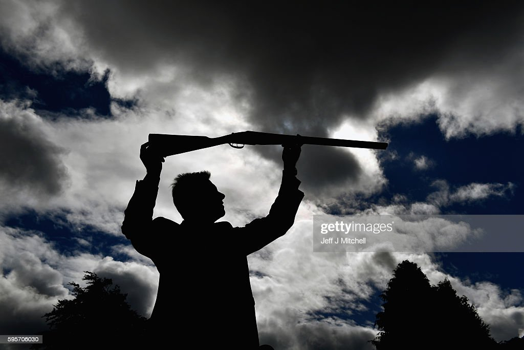 Auctioneer Gavin Gardiner holds a 12-bore 'Royal de Luxe' model self-opening sidelock ejector gun by Holland and Holland at Gleneagles Hotel on August 26, 2016 in Aucterarder, Scotland. The annual auction of Fine Modern and Vintage sporting guns and rifles, which is now in its 49th year, takes place on August 29 at the Gleneagles Hotel.