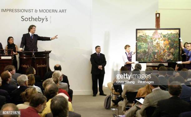 Auctioneer Guy Jennings takes the final bid for 'Landscape at Krumau' by Austrian expressionist painter Egon Schiele at Sotheby's in Central London *...