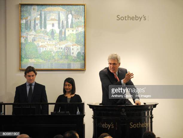 Auctioneer Henry Wyndam sells Gustav Klimt's Kirche in Cassone for 26250 during the Impressionist and Modern Art Evening Sale at Sotheby's London...
