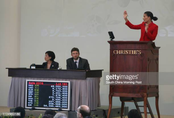 Auctioneer in action asking for a price on Xu Beihong Slave and Lion oil on canvas painted in 1924 sold for HKD$53000 World auction record for a...