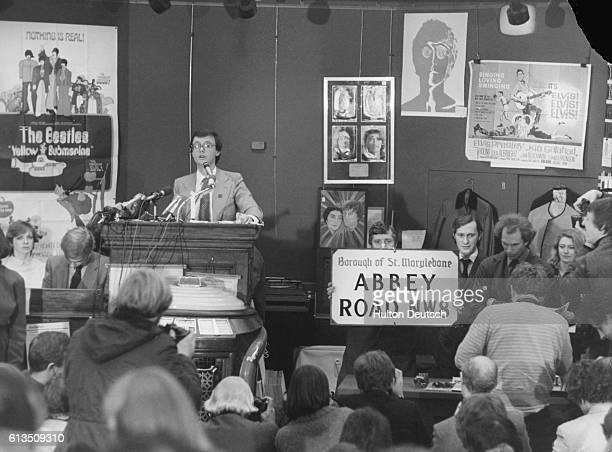 Auctioneer Jon Baddeley sells Beatles and pop memorabilia at Sotheby's A street sign of Abbey Road is sold for £320 circa 1970