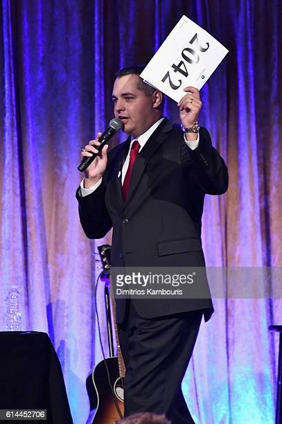 Auctioneer Jonathan Kraft speaks onstage during Global Lyme Alliance's second annual United For A LymeFree World gala on October 13 2016 in New York...