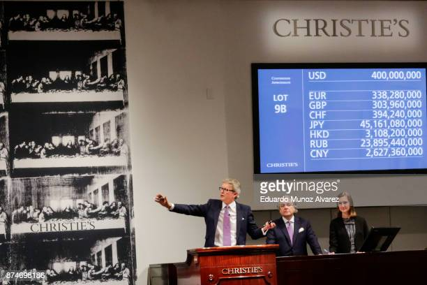 Auctioneer Jussi Pylkkanen gestures as he sells the painting of the auction of Leonardo da Vinci's 'Salvator Mundi' during the PostWar and...