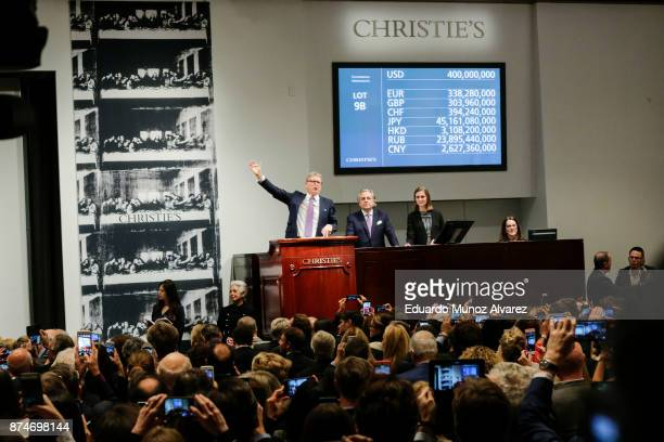 Auctioneer Jussi Pylkkanen gestures as he sold the painting of the auction of Leonardo da Vinci's Salvator Mundi during the PostWar and Contemporary...