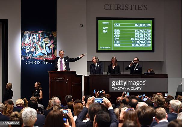 Auctioneer Jussi Pylkkanen holds his hands up after the Picasso masterpiece 'Les Femmes d'Alger ' sold for USD1793 million at Christie's in New York...