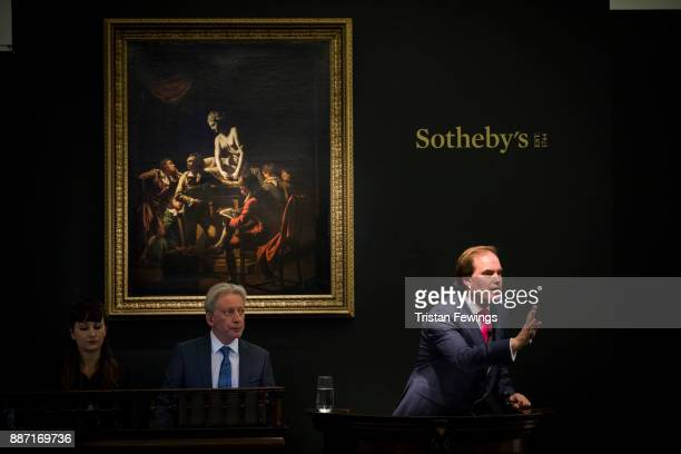 Auctioneer Lord Dalmeny fields bids at Sotheby's Old Masters Evening Sale at Sotheby's on December 6 2017 in London England The auction totalled £25...