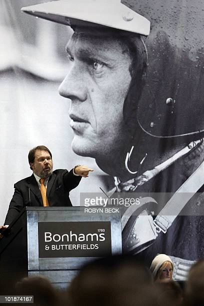 Auctioneer Malcolm Barber of Bonhams and Butterfields takes bids at the auction of motorcycles cars and other memorabilia owned by the legendary US...