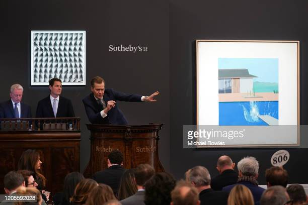 Auctioneer Oliver Barker brought the hammer down on David Hockney's landmark pool painting 'The Splash', which achieved £23.1 million / $29.8 million...