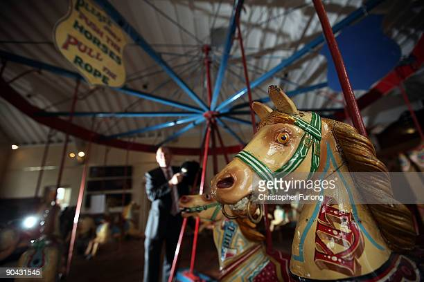 Auctioneer Robert Stones poses next to a Victorian carousel that wil be going under the hammer at the Peter Wilson auction rooms on September 8 2009...
